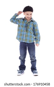 Full length portrait of smiling little boy in jeans and cup dancing hip-hop on white background