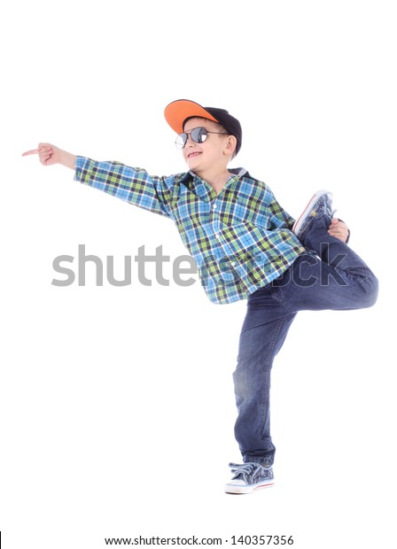 Full length portrait of smiling little boy in jeans, cup and sunglasses on white background