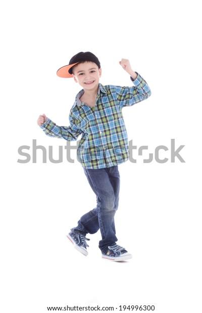 Full length portrait of smiling little boy in jeans on white background
