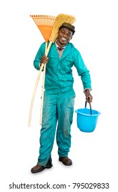 Full length portrait of smiling male african garden worker.Young man holding broom, rake and bucket isolated on white background.