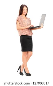 Full length portrait of a smiling professional woman holding a laptop isolated on white background