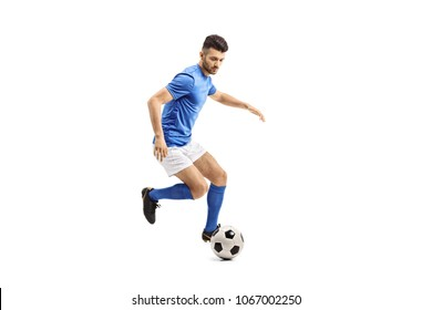 Full length portrait of a soccer player dribbling isolated on white background