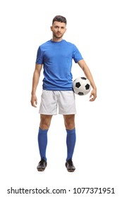 Full length portrait of a soccer player holding a football and looking at the camera isolated on white background