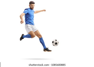 Full length portrait of a soccer player in mid-air kicking a football isolated on white background