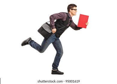 Full length portrait of a student in rush running with notebook isolated on white background