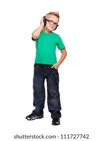 Full length portrait if a stylish boy in headphones