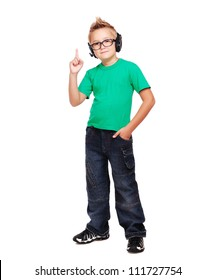 Full length portrait if a stylish boy in headphones pointing with finger