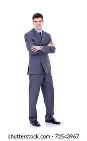 Full length portrait of a successful business man with hands folded isolated on white
