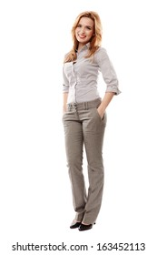 Full length portrait of successful businesswoman with hand on hip smiling, isolated on white background