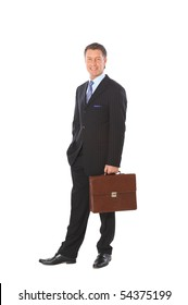 Full length portrait of a successful mature business man with hands folded isolated on white