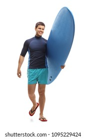 Full length portrait of a surfer holding a surfboard and walking towards the camera isolated on white background