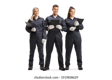 Full length portrait of a team od female and male mechanics in uniforms isolated on white background