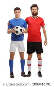 Full length portrait of a teenage boy and his father with a football dressed in sportswear isolated on white background