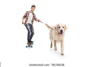 Full length portrait of a teenage hipster with a longboard walking a dog isolated on white background