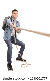 Full length portrait of a teenage student pulling a rope isolated on white background