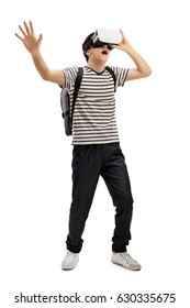 Full length portrait of a teenage student with a VR headset isolated on white backgroundh