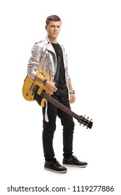 Full length portrait of a teenager with an electric guitar isolated on white background