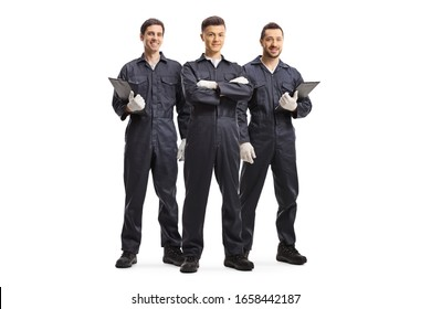 Full length portrait of three mechanic workers in uniforms isolated on white background - Shutterstock ID 1658442187