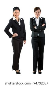 Full length portrait of two happy Asian business women