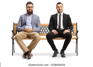 Full length portrait of a two men sitting on a bench isolated on white background