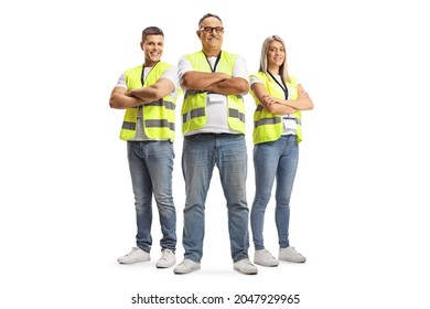 Full length portrait of two men and a woman wearing a reflective safety vests and posing with crossed arms isolated on white background