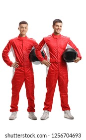 Full length portrait of two young racers standing and holding helmets isolated on white background