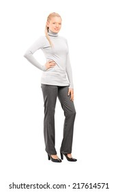 Full length portrait of a woman in casual clothes posing isolated on white background