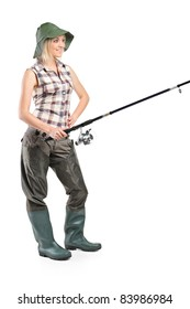 Full length portrait of a woman holding a fishing pole isolated on white background