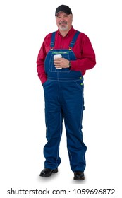 Full length portrait of a worker in denim dungarees, cap and red shirt standing smiling at the camera holding a cup of takeaway coffee isolated on white