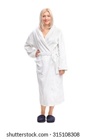 Full length portrait of a young blond woman in a white bathrobe isolated on white background