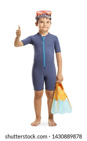 Full length portrait of a young boy in a wetsuit holding swmming fins and showing thumb up isolated on white background