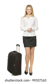 Full length portrait of young business woman standing with black travel bag isolated on white background