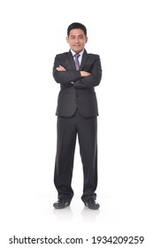 Full length portrait of young businessman with arms crossed standing on white background