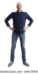Full length portrait of a young casual bald man isolated on white background.