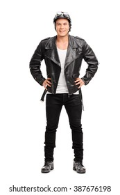 Full length portrait of a young cheerful biker in a black leather jacket isolated on white background
