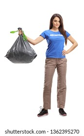 Full length portrait of a young female volunteer holding a plastic waste bag isolated on white background