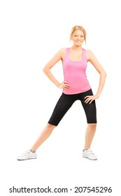 Full length portrait of a young girl stretching her thighs isolated on white background