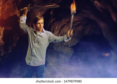 A full length portrait of a young goodlooking guy with a sword. Men casual fashion, Jedi.