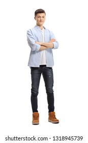 Full length portrait of a young male posing with crossed arms isolated on white background
