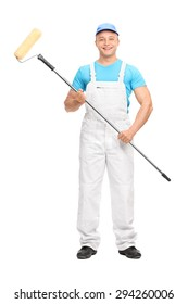 Full length portrait of a young male house painter in a white overalls holding a paint roller and looking at the camera isolated on white background