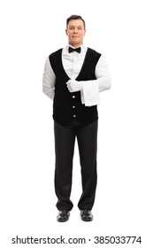 Full length portrait of a young male waiter holding a white towel isolated on white background