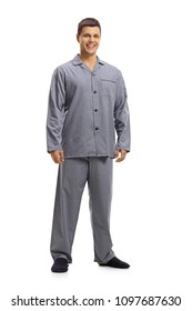 Full length portrait of a young man in pajamas smiling isolated on white background
