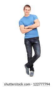 Full length portrait of a young man leaning on a virtual wall isolated on white background