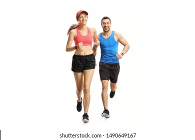 Full length portrait of a young man and woman jogging isolated on white background