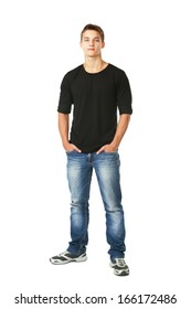 Full length portrait of young man standing with hands in pockets  isolated on white background