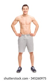 Full length portrait of a young man posing shirtless isolated on white background