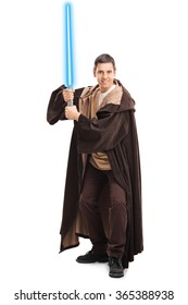 Full length portrait of a young man in warrior costume holding a blue laser sword isolated on white background