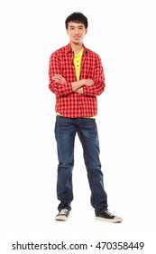 Full length portrait of young man standing with crossed arms