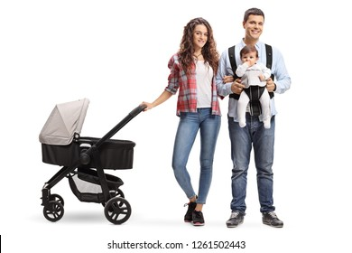 Full length portrait of a young mother with a stroller and a father with a baby in a carrier isolated on white background