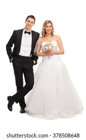 Full length portrait of a young newlywed couple posing together isolated on white background